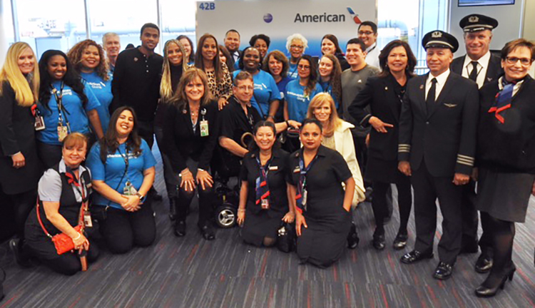Bruce Sickler, seated center, poses with LAX volunteers at the It's Cool to Fly event.