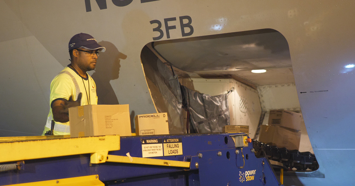 MIA team members load supplies on American's relief flight to the Bahamas