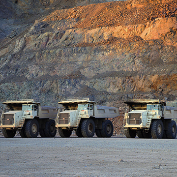 4 100 tonne Haul Trucks at the El Gallo Mine in Sinaloa, Mexico. On average 35,000 tonnes of rock are moved each day.
