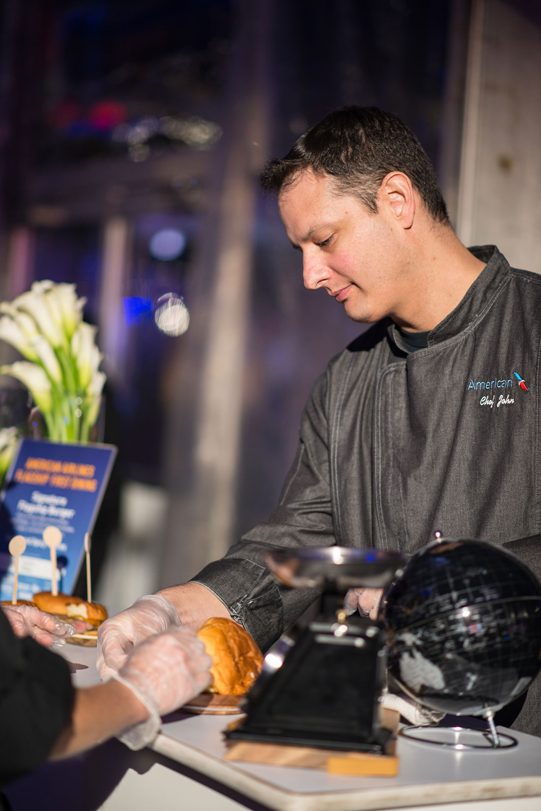 American Airlines Chef John Ogden presented NYCWFF attendees with the signature Flagship Burger.