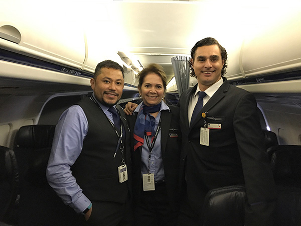 New York City-based flight attendants Niko Gutierrez, Kathy Iannettoni and Tony Hernandez prepare for members of Team Rubicon to board at John F. Kennedy International Airport.