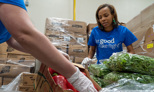 Volunteers helped sort food items for families in Fort Worth.