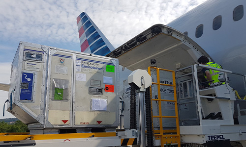 Crates of temperature-controlled pharmaceuticals are loaded into aircraft for a cargo-only flight from ZRH to PHL.