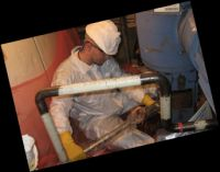 fluid sealing technician performing an assessment
