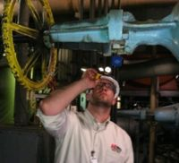 technician surveying valves
