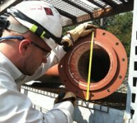 technician measuring a valve